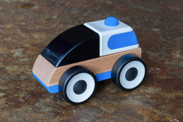 Simple wood and plastic toy police car