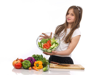 A young teenage girl holding a bowl of salad isolated on white..