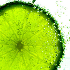 lime with bubbles isolated on white