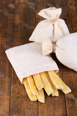 Bread sticks  in sack on wooden background