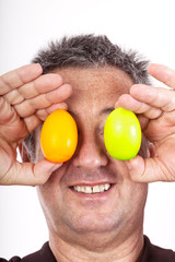 Man holding Easter eggs in front of the eyes