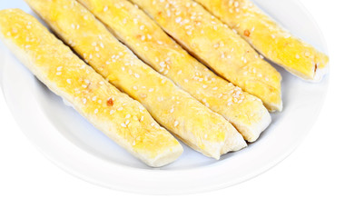 Tasty bread sticks isolated on white