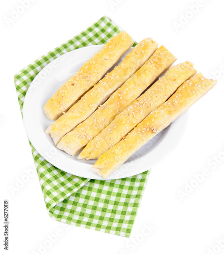 Tasty bread sticks on plate isolated on white