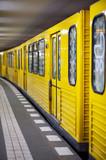 Yellow metro in subway station. Berlin, Germany.