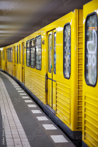 Yellow metro in subway station. Berlin, Germany.