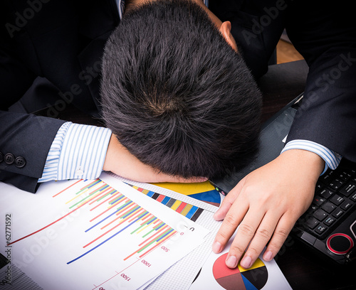 Exhausted and tired businessman sleeping in office