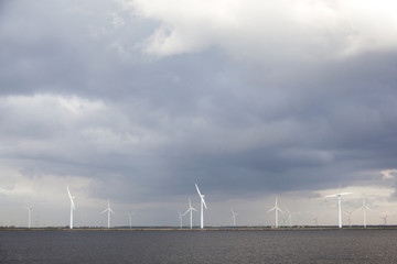 wind turbines and cloudy sky