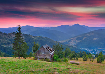Colorful summer sunset in the mountain village.