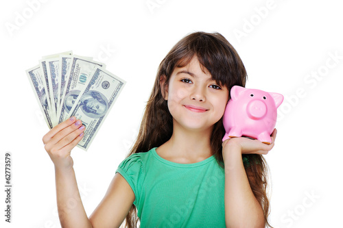 girl holding money and piggy bank