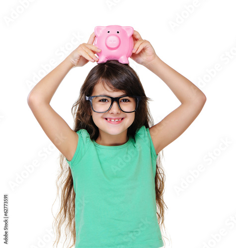 girl holding piggy bank on head