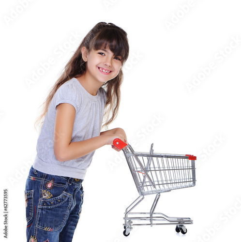 girl holding shopping trolley side view