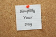 Simplify Your Day message on a cork notice board