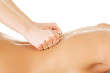 Woman relaxing beeing massaged in spa saloon