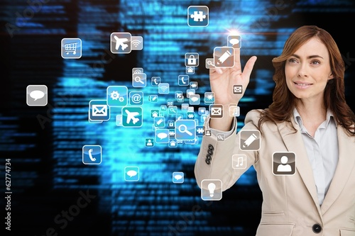 Smiling businesswoman pointing to app icon