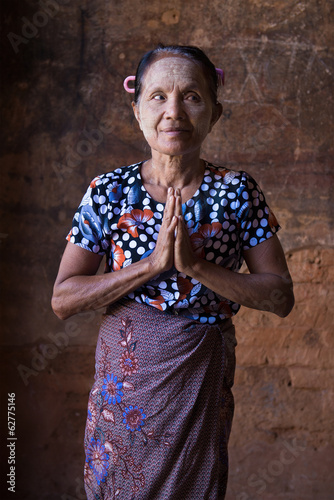 old asian senior woman in traditional clothes in traditional gre