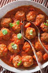 meatballs with tomato sauce in pan with spoon