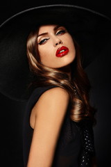 beautiful sexy stylish model with bright makeup with red lips