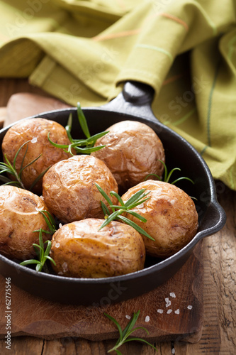 baked potatoes in black pan