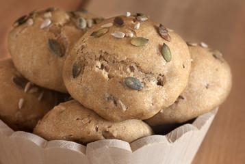 multigrain buns in wooden bowl