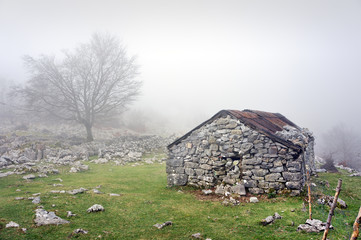 stone shed in mountain with fog