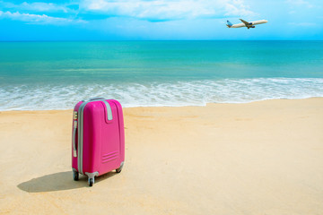 Suitcase at the sunny beach