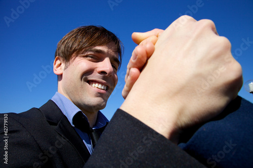 Cool business man happy holding hand of partner