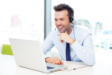 Businessman with headset talking