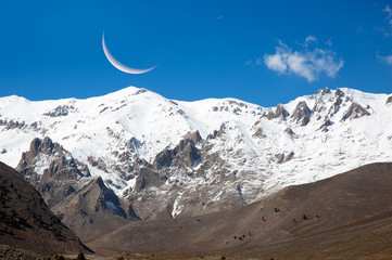 moon over snowy mountains
