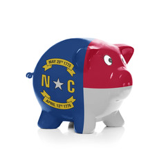 Piggy bank with flag coating over it - State of North Carolina