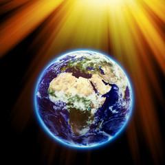 Sun rays over earth