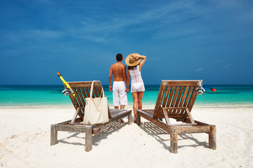 Couple in white on a beach at Maldives