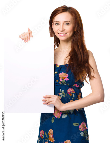 Young woman is holding blank banner