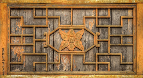 The ancient wooden wall frame is decorated with carving wood