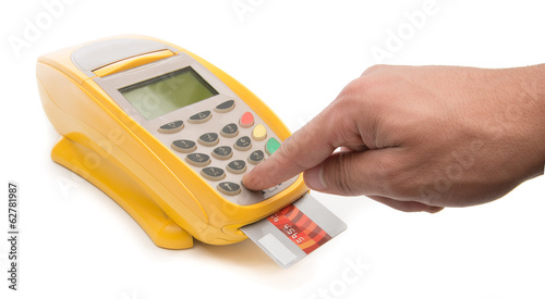 Male hand enters PIN code on payment terminal