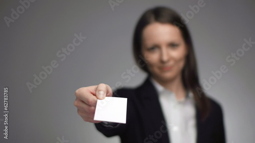 businesswoman giving a business card