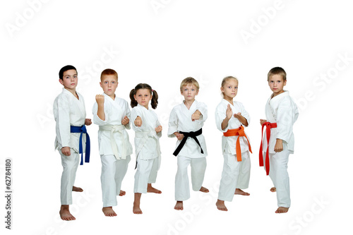 Six young athletes perform karate techniques