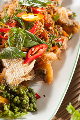 thai food, fried fish decorated with Thai herb with fried basil
