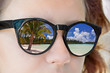 Beach reflection in a girl sunglasses
