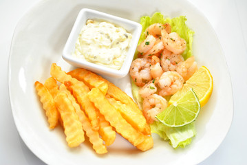 Gourmet Meal of Shrimp and French Fries
