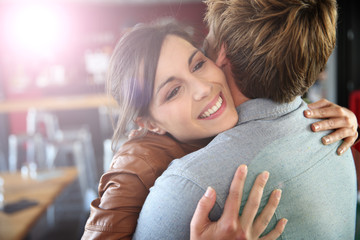 Brunette girl happy to see her boyfriend again
