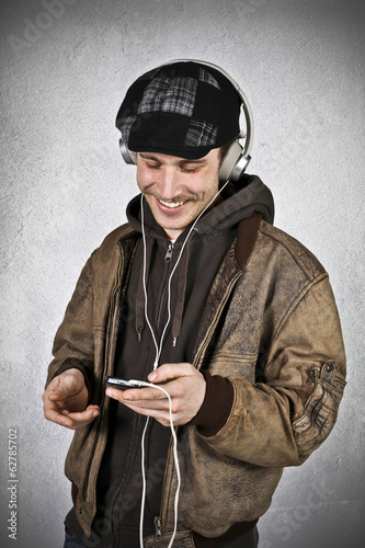 Portrait of happy guy with headphones