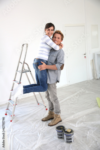 Young man holding girlfriend in arms