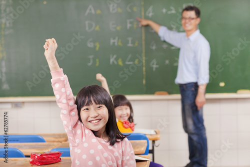 pupils raising hands during the lesson with teacher