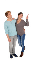 Cheerful young couple pointing at message, isolated