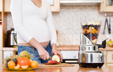 Pregnancy and nutrition - pregnant woman with fruits
