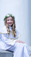 First Communion beautiful girl on the white background