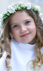 First Communion smiling girl