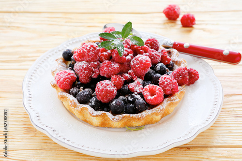 tartlet with fresh raspberries and currants