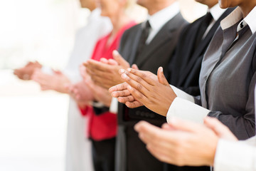 group of businesspeople clapping hands