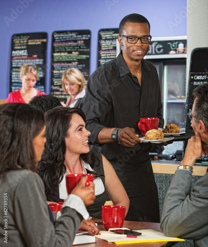 Waiter Bringing Food to Customers